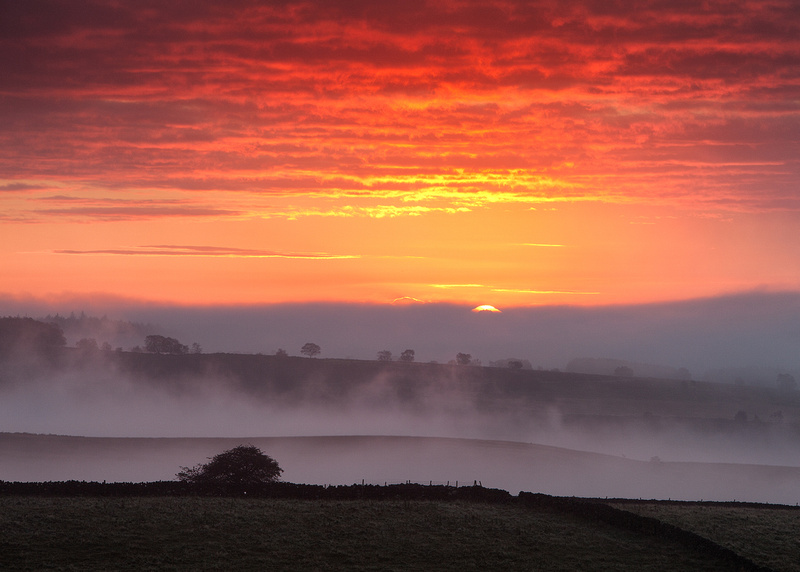 Misty sunrise behind Curbar Edge